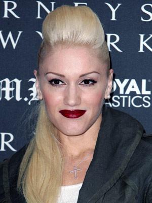 Gwen Stefani rocks a smooth ponytail and pretty pompadour pouf.
