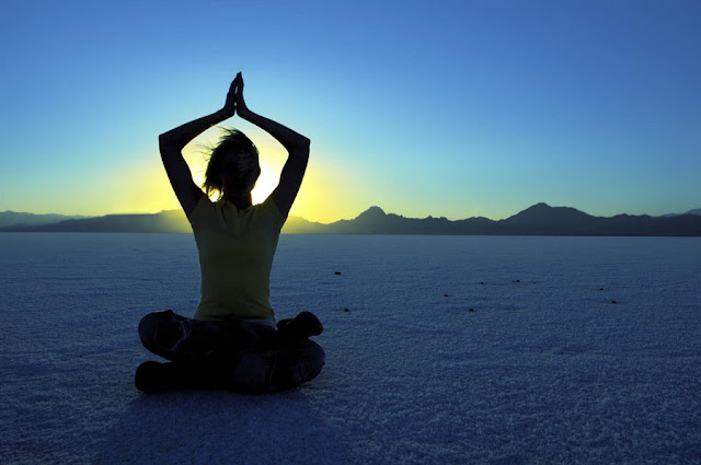 Woman in desert for triangle meditation