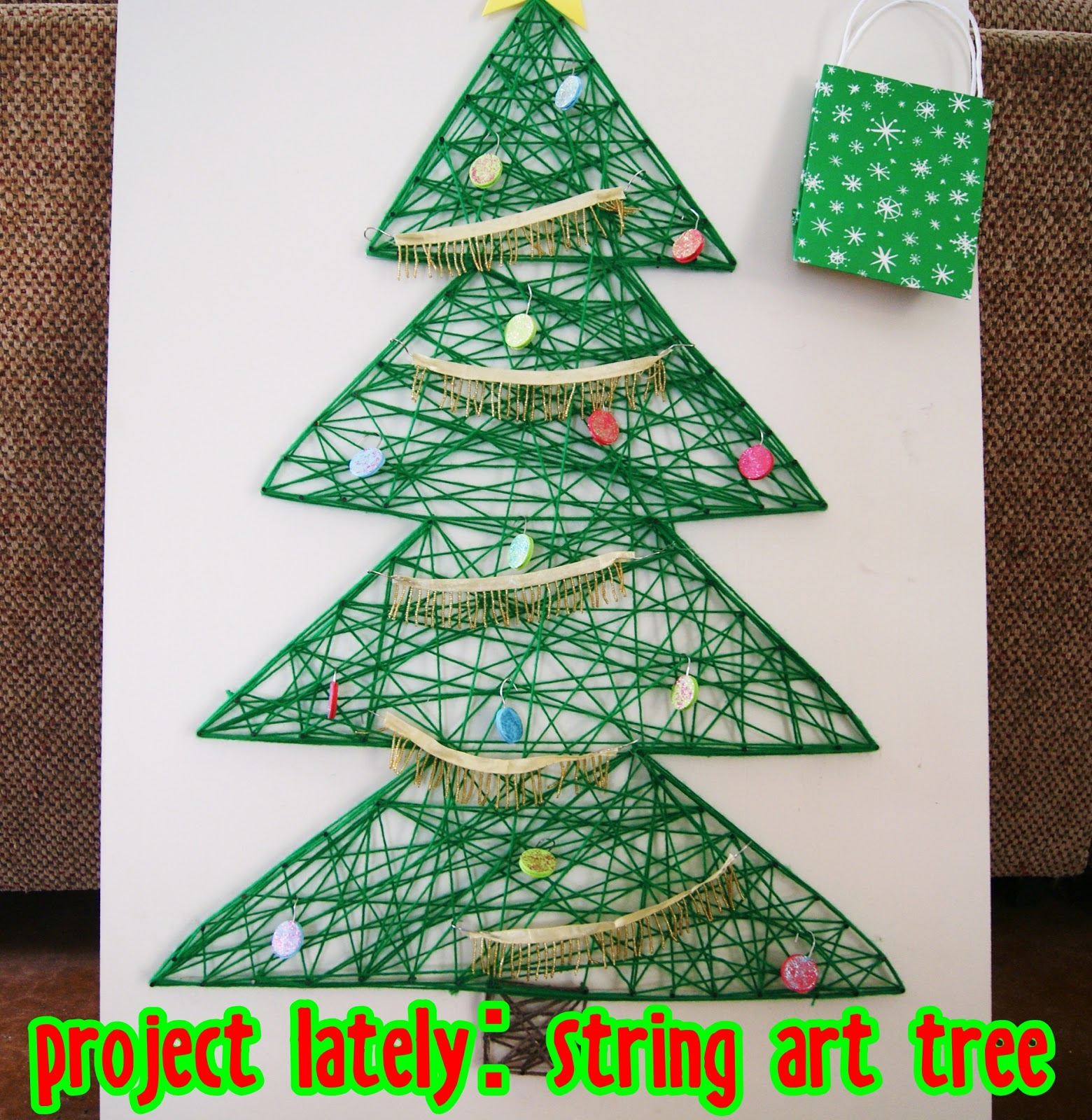 Christmas Tree Art Projects For Kids Up this string art tree.