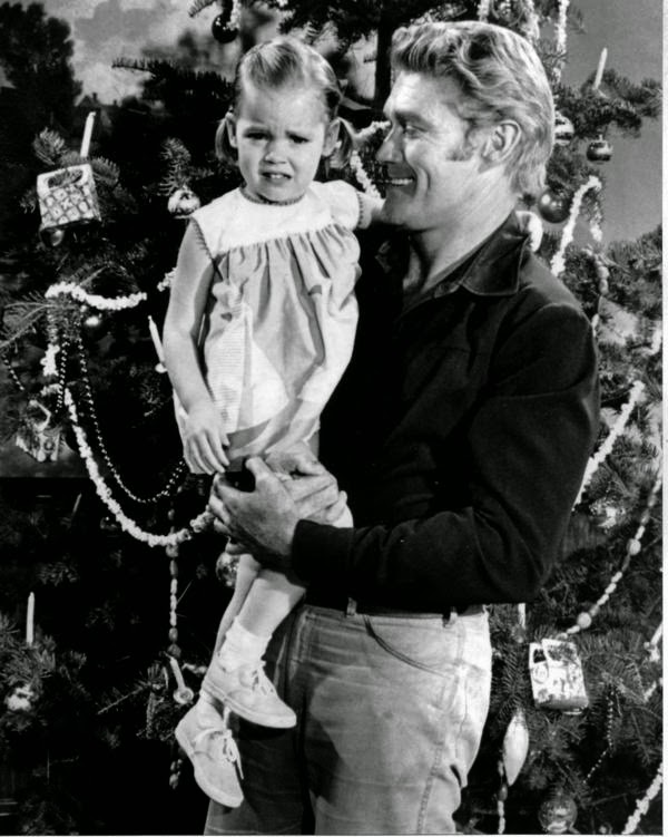 Chuck Connors and daughter at home for Christmas.