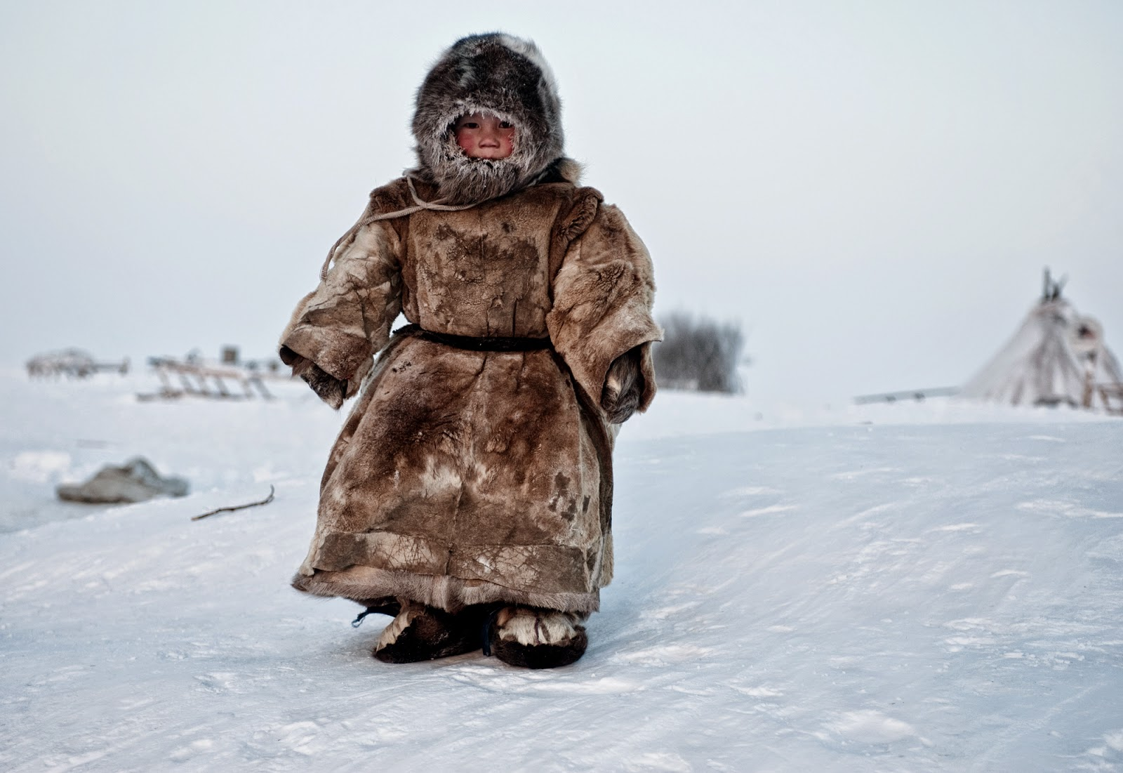 Copyright: ©Simon Morris, United Kingdom, Shortlist, Smile, Open, 2015 Sony World Photography Awards. Image Name: On the Tundra.... Description: A Young Nenets boy plays in -40 degrees on Yamal in the Winter in Siberia.