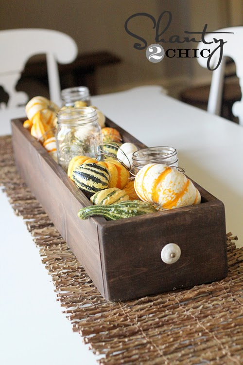 http://www.shanty-2-chic.com/2012/09/fall-table-centerpiece.html