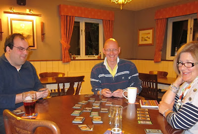 Players during a game of Dominion