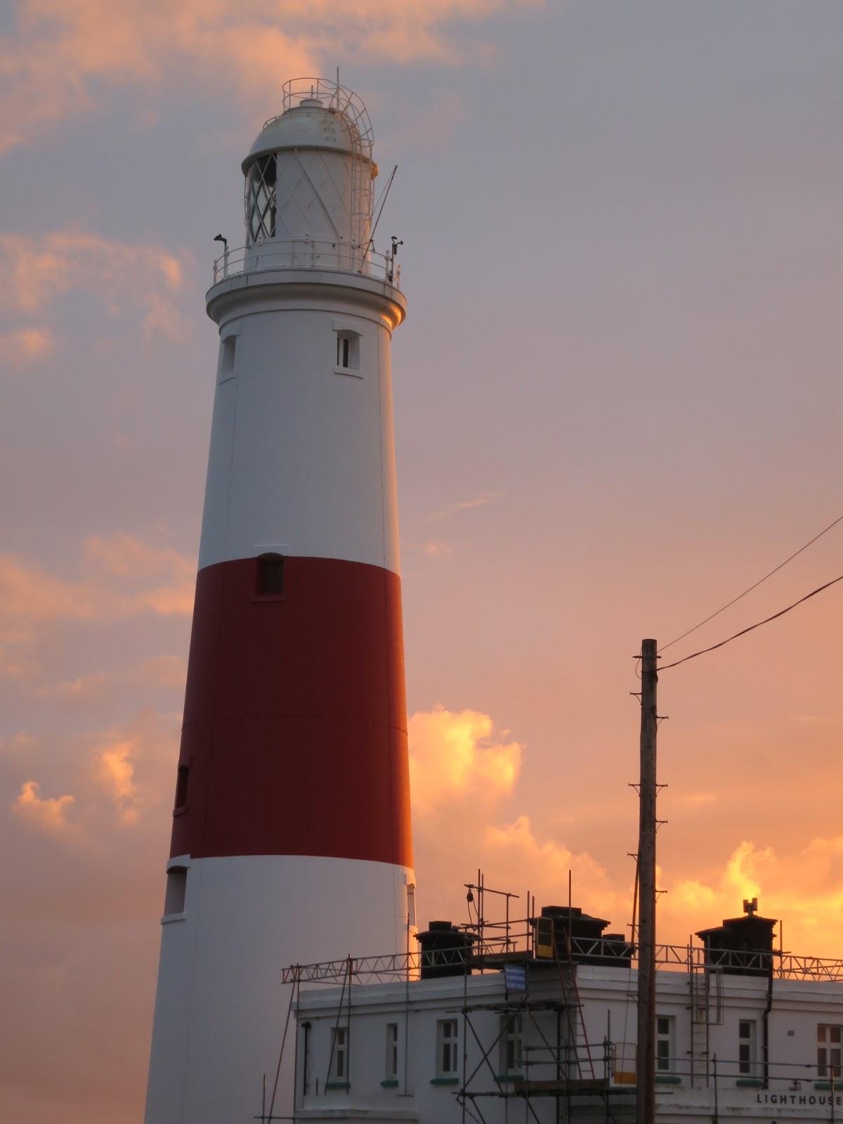 Portland Bill Lighthouse against sugar almond evening sky.
