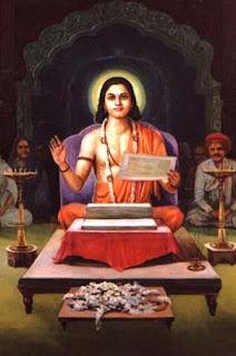 Jneshwar sits at his writing desk