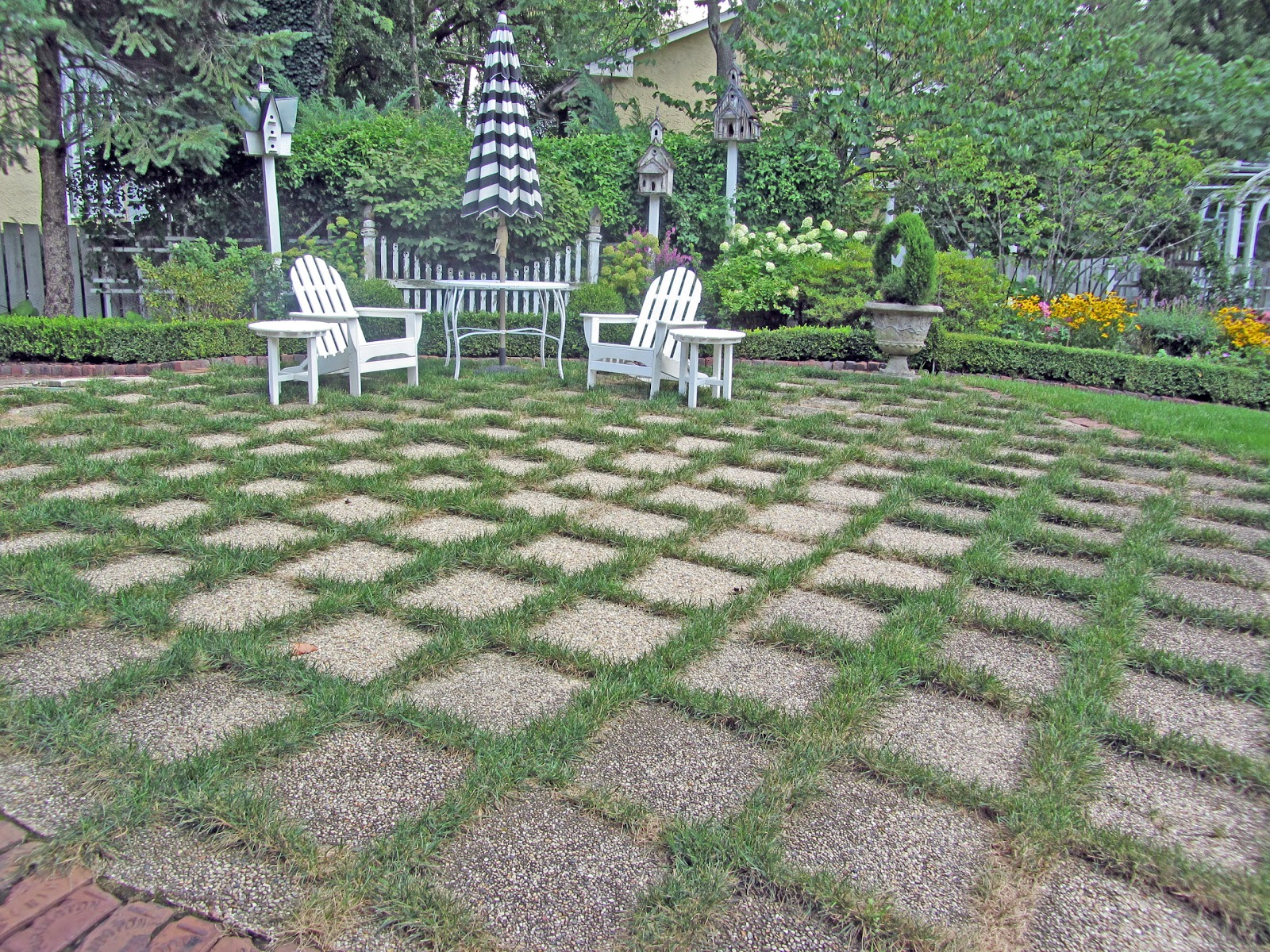 A Grass And Stone Patio, Difficult To Keep Green This Summer.