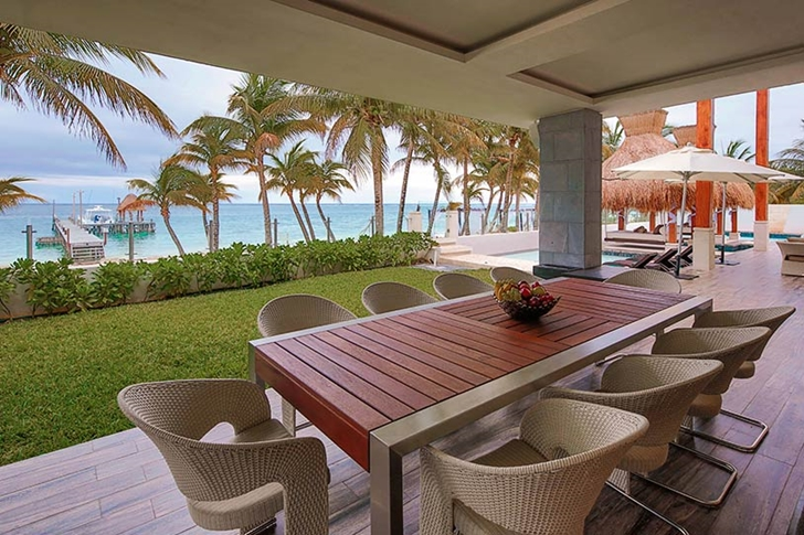 Terrace with dining table in Modern villa on the beach in Mexico
