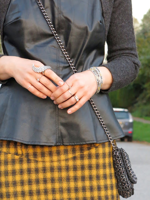 plaid pencil skirt, faux-leather peplum top, wool shrug, and feather ring