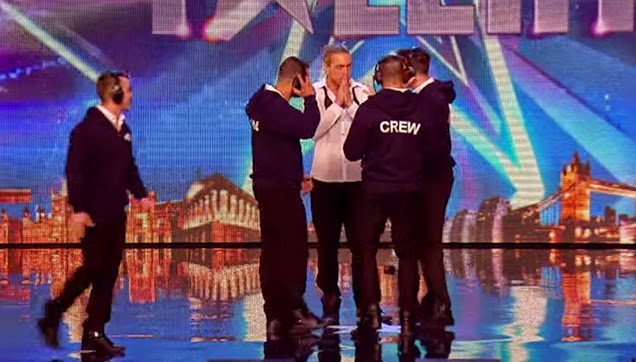The crew rushed to the stage to assist Lewis.