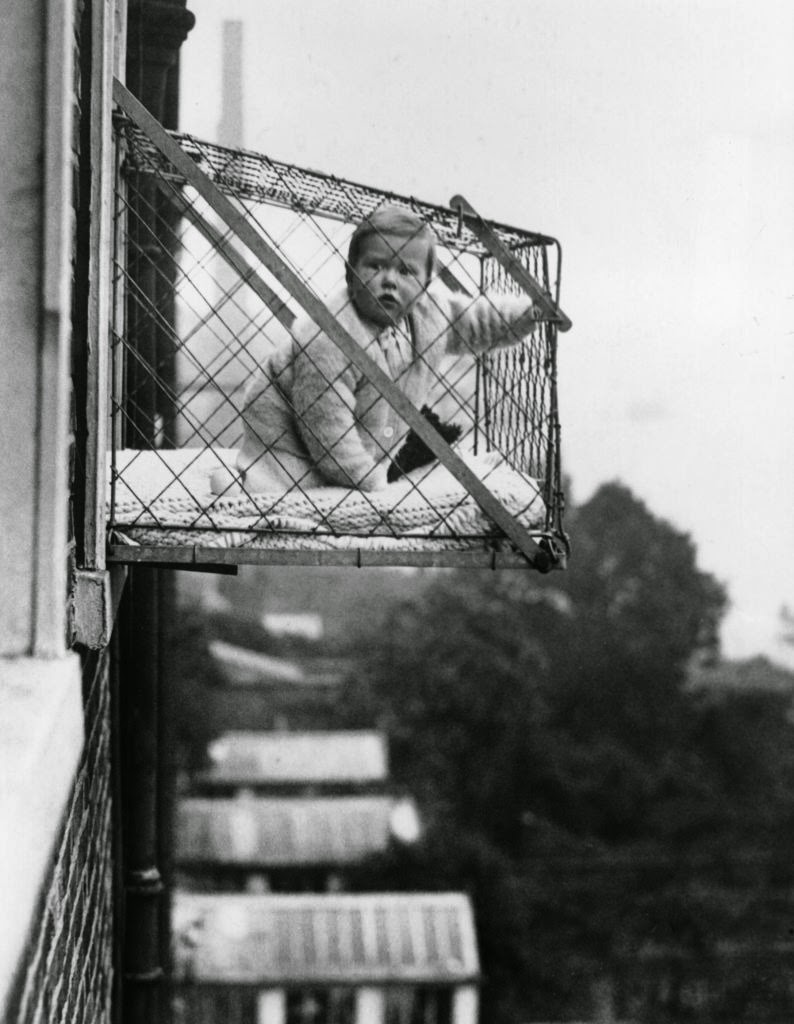 Incredible Pictures Of Baby Cages Hanging Outside London Apartment