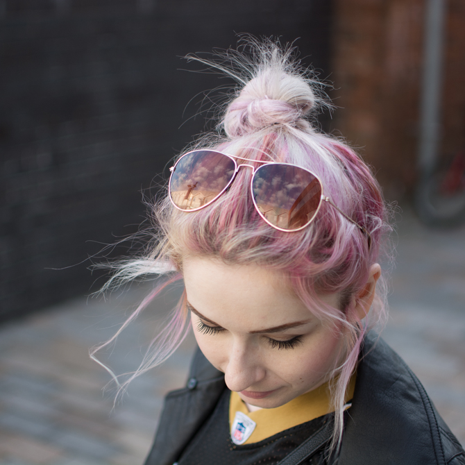 aviator sunglasses styling top knot bun with pink hair