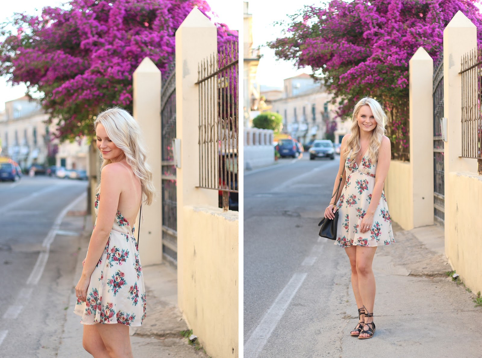 a blonde girl stands in front of purple flowers, wearing a floral dress in italy