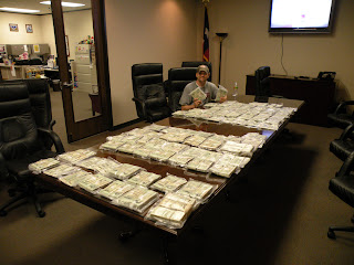 DEA Agent Nate Fountain poses with $10 million seized from a Mexican drug trafficking ring.