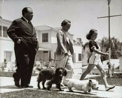 Alfred Hitchcock wife Alma and daughter Pat walking the dogs in 1939.