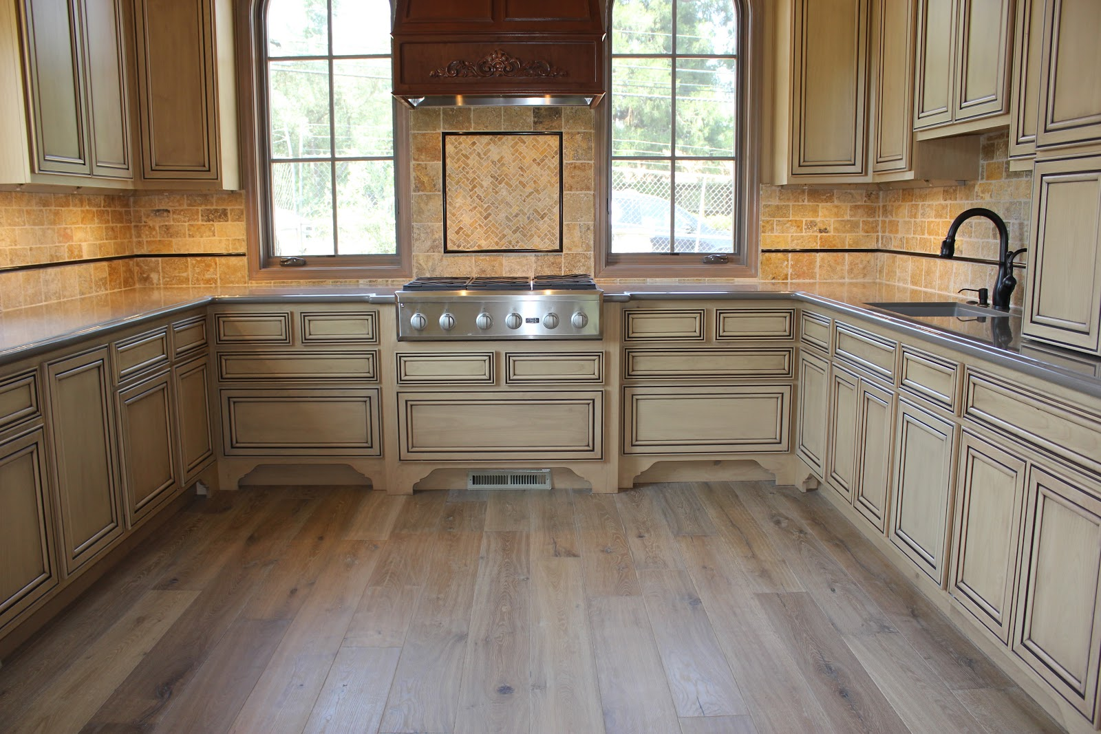 Simas floor and design company hardwood flooring by royal oak for Hardwood floor tile kitchen