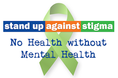 Green Ribbon.  Text: Stand up against stigma. No Health without Mental Health