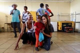 In a first photo, she poses with a young child in the premises of HIVSA