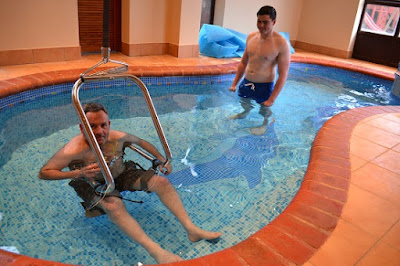 Jason Miller with his body support pool access system