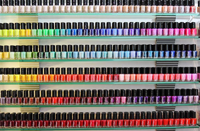 nail enamel in a row on a shelf