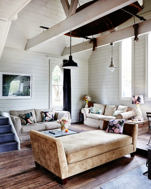 living room in a home with reclaimed wood floor and pendant lights