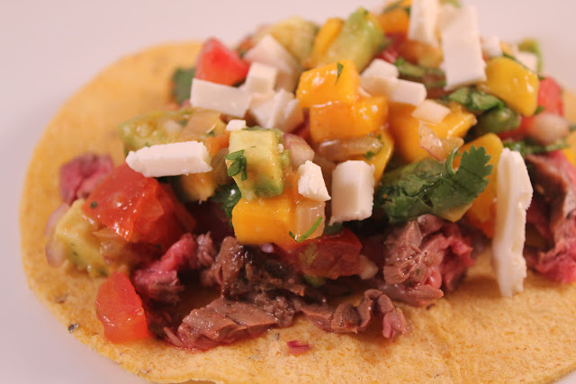 Skirt steak tacos with mango guacamole