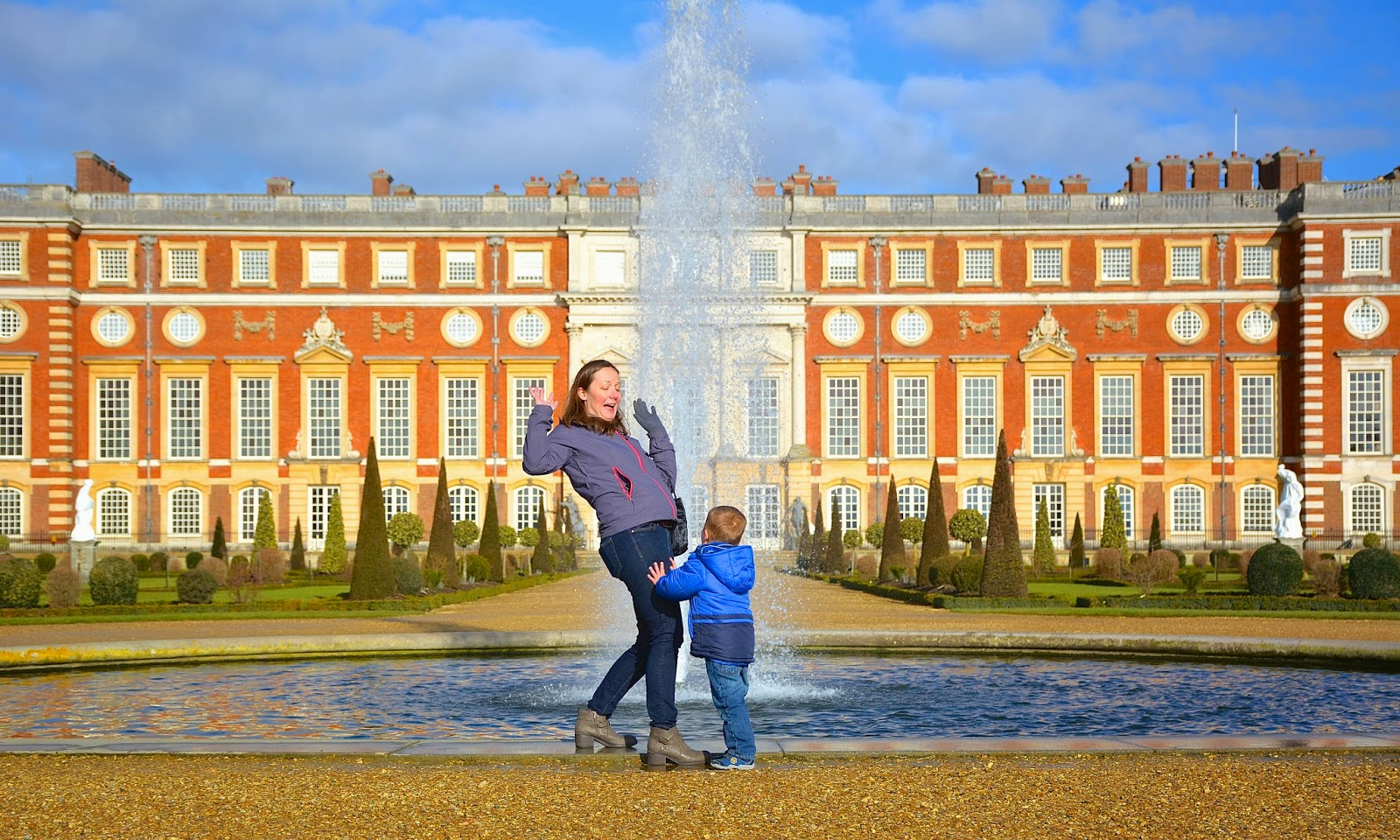 Pushing mommy into the fountain at Hampton Court Palace