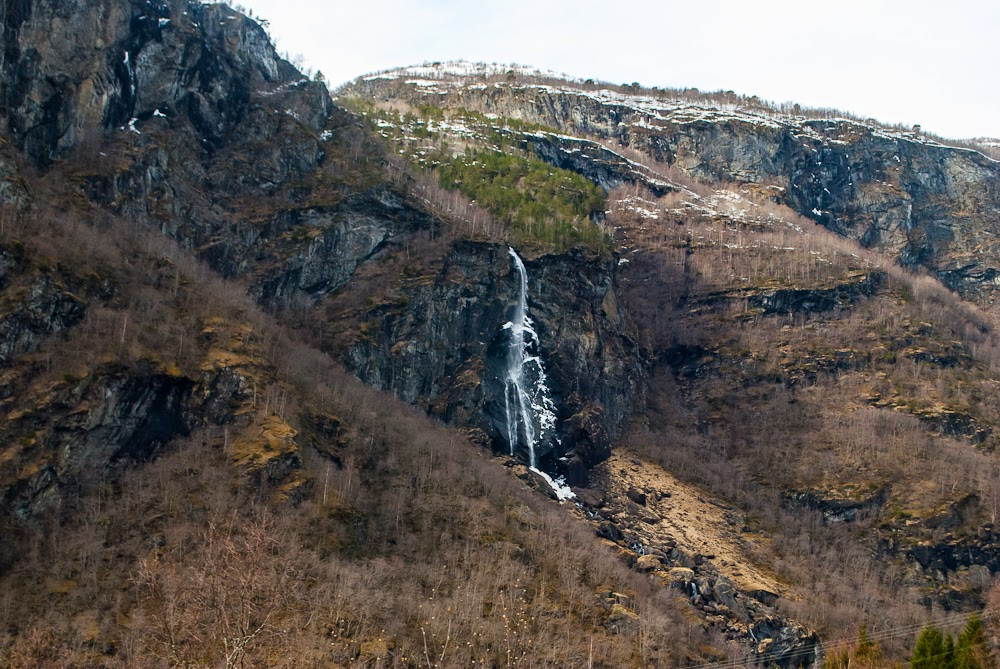Passing by waterfalls whilst on norway in a nutshell tour flam railway