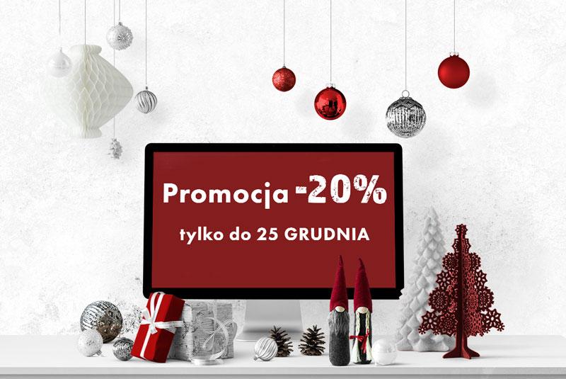 Monitor komputera na biurku z ozdobami świątecznymi, na ekranie napis Promocja -20% trwa do 25 grudnia