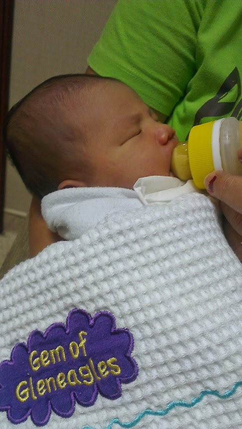 Picture of Kei's mom bottlefeeding Elise on July 13, 2013, 8:20pm