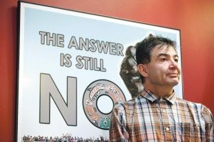 Chief Francis Laceese, of the Tl'esqox First Nation, stands by a poster showing opposition to the Enbridge Northern Gateway Pipeline during a news conference in Vancouver, B.C., after the Supreme Court of Canada ruled in favour of the Tsilhqot'in First Nation, granting it land title to 438,000-hectares of land Thursday. (Credit: The Canadian Press) Click to enlarge.