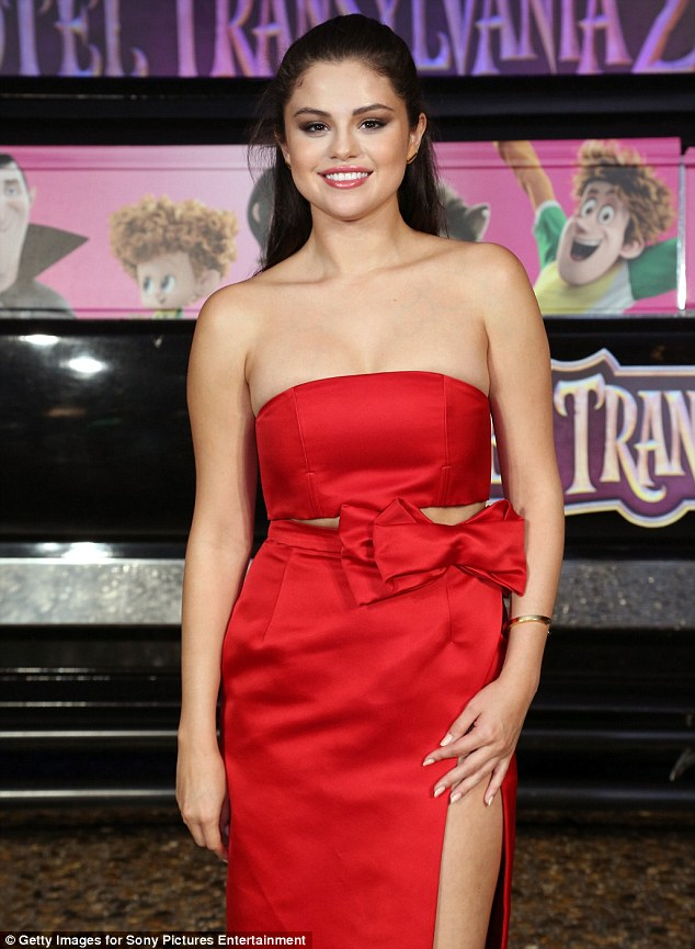 Selena Gomez in a shiny rose-coloured dress with VERY high split at Hotel Transylvania 2 photocall