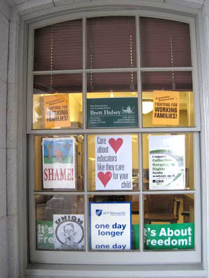 Large window with pro-union signs in every pane