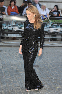 Kylie Minogue strikes a pose in a tight black dress