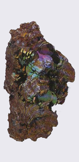 HEMATITE The play of colours on the surface of these hematite crystals from Elba is called iridescence. It is due to the interference of light in thin surface films.