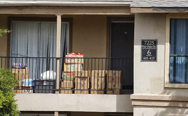 Family members of Dallas Ebola patient confined to home under armed guard