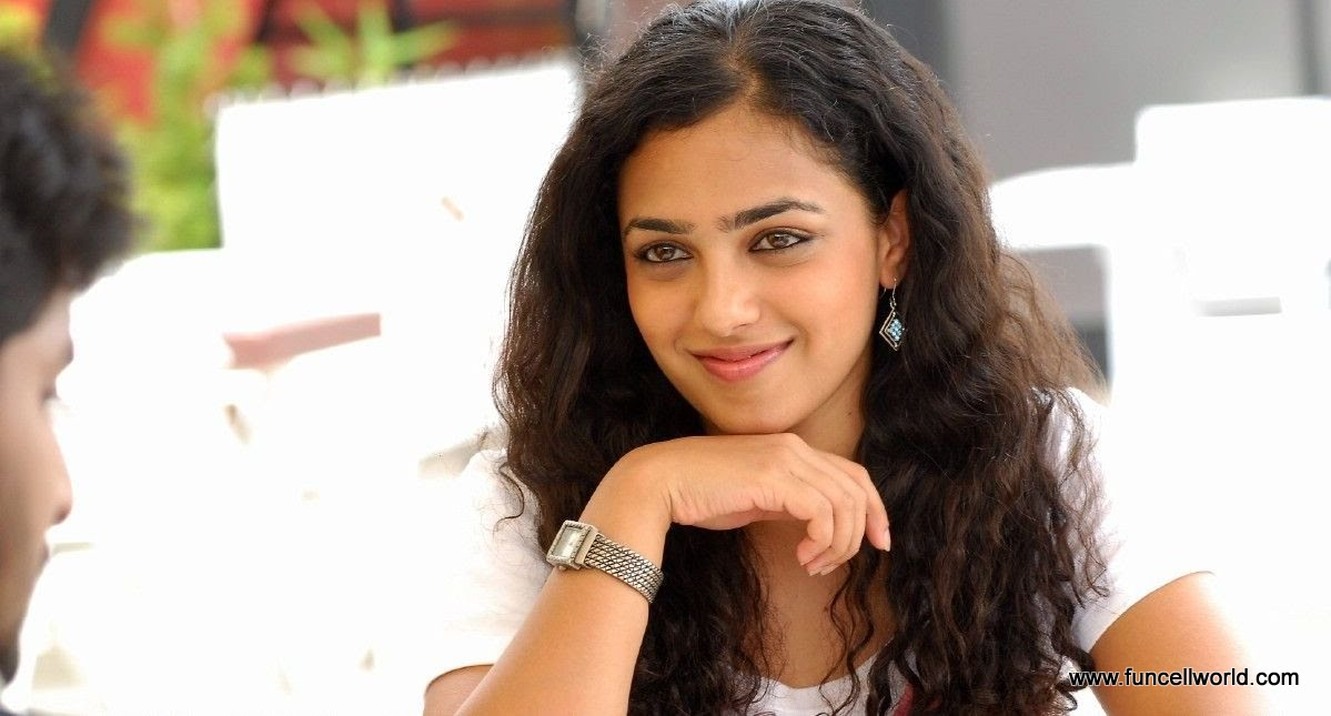 ... at your wish place: Nithya Menon Hot in Ala Modalainde Movie Photos