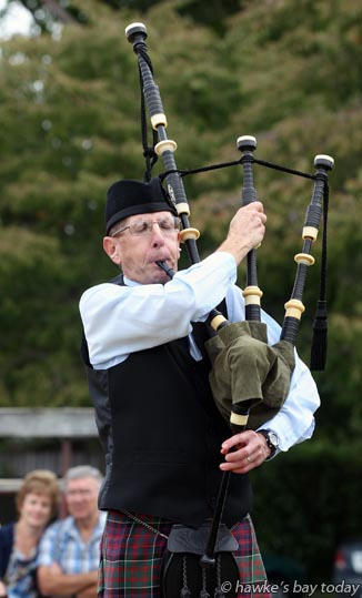 Linsay May, tuning up for a piping event at the Hawke's Bay Easter Highland Games, Lindisfarne College, Hastings photograph