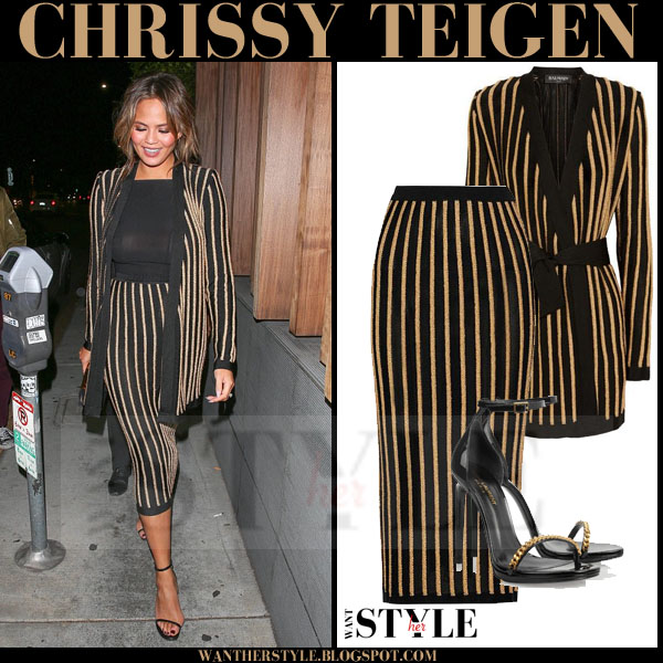 Chrissy Teigen in striped black and gold balmain cardigan and matching striped balmain pencil skirt what she wore model style