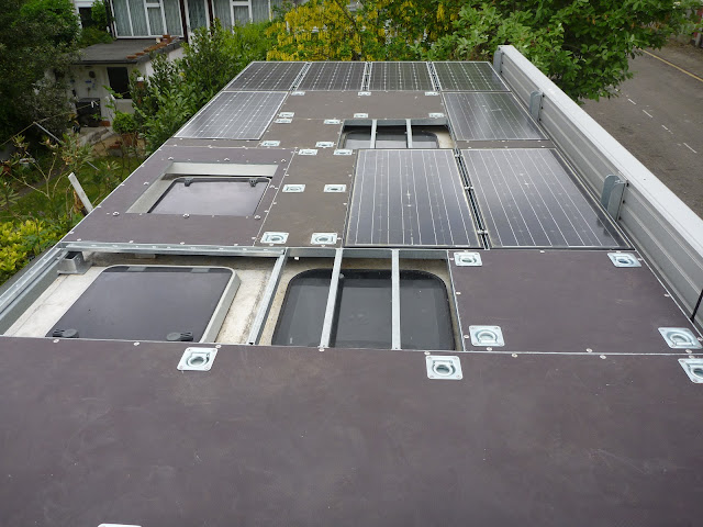 the tropical roof populated with solar panels and buffalo board decking