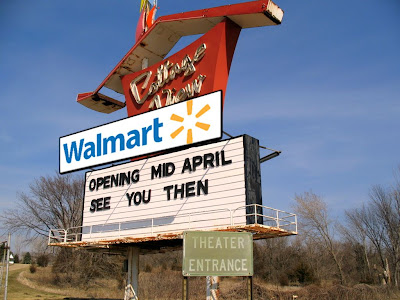 The Cottage View drive-in sign with a Walmart logo attached