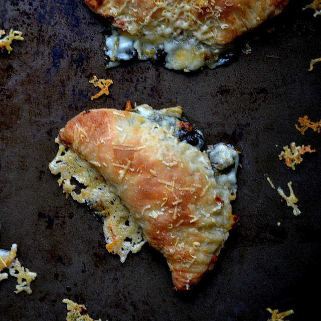 spinach artichoke hand pies on a pan