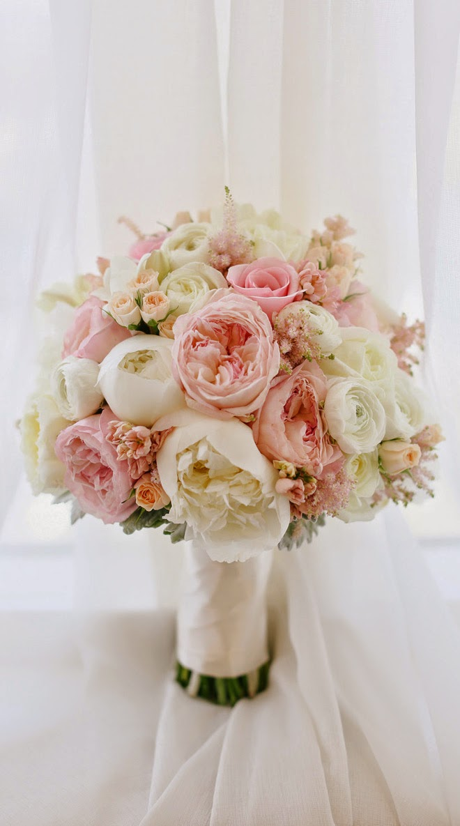 Glamorous pink bouquet with garden roses, peonies, ranunculuses and roses