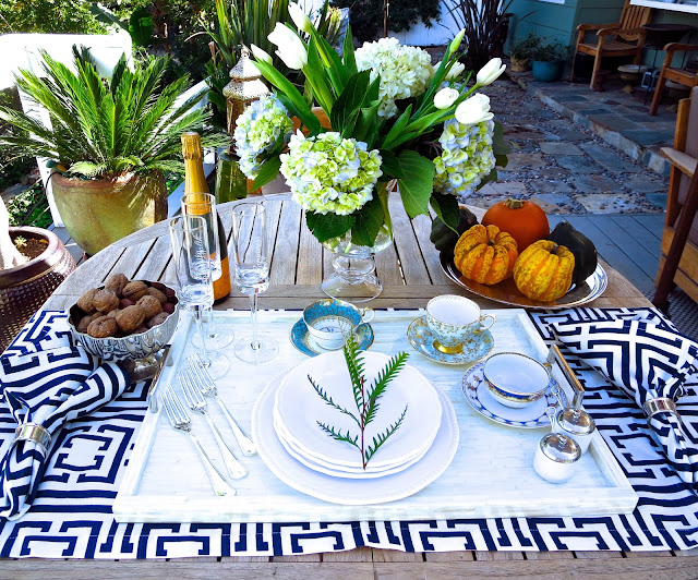 Casual outdoor fall tea setting with COCOCOZY logo napkins and placemats