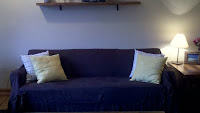 and after... it's brown with bright yellow throw pillows, though you cannot tell in this poor pic.