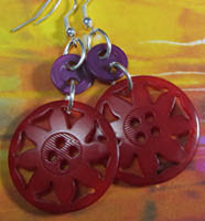 Striking drop dangle earrings have red sunflower buttons hanging from small darker red buttons