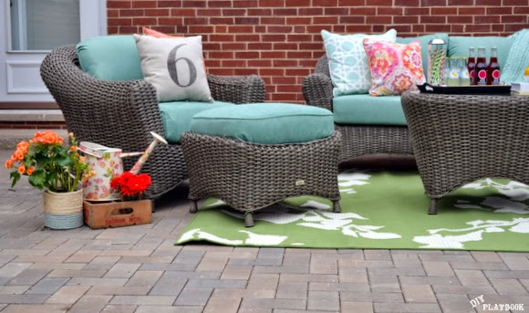Home Decorators Collection Patio - These are our new gray wicker chairs, ottamans and table with blue cushions. Check out the cute green rug!