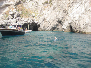 Swimming in the cove outside the Green Grotto.  The main cave is hidden along the right cliff.