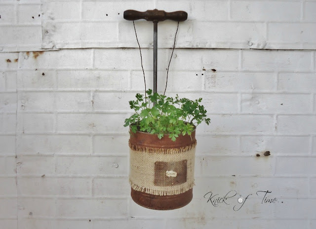 Repurposed Tin Cans and Wooden Handles by http://knickoftimeinteriors.blogspot.com/