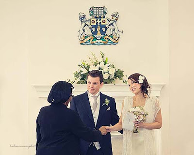 bride and groom receiving their marriage certificate at Marylebone Town Hall wedding