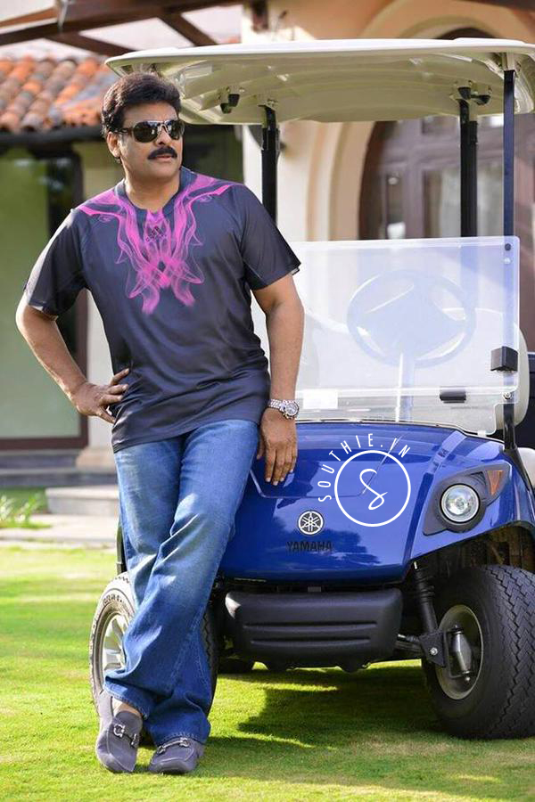 Megastar Chiranjeevi in a Graphic Tee, standing next to a golf cart.